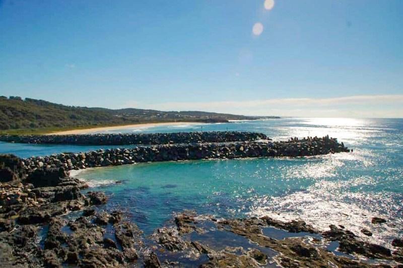 crystal blue sea with black rocks along the coastline of Narooma