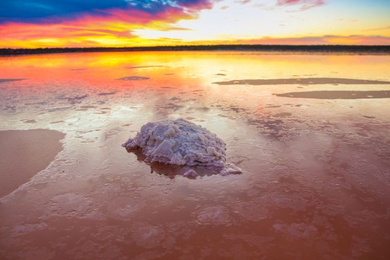 pink lake at Murray-sunset national park with salt formation piled up during sunset