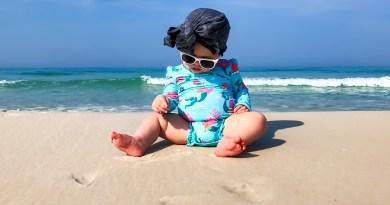 best baby sunscreen sun cream baby on beach with hat