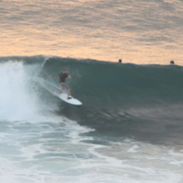Surfing a left hand wave, barrel sequence
