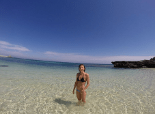 Tegan standing in the crystal clear shallows