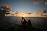Tegan and Grete trying to create a photo that looks like they are holding the sun...and failing
