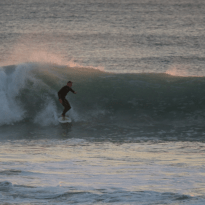 Dan surfing a left hander, sequence shot of turns and pulling in to the barrel