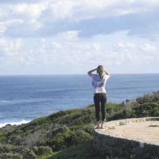 Tegan looking out over the ocean from a lookout in Margaret River