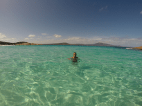 Swimming in the cold but super clear water of the beach