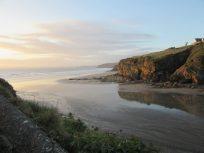 Sunset providing golden colour to the cliffs surrounding Little Haven beach