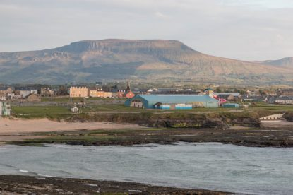 The tiny town of Bundoran. Mountain in the background