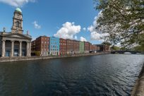 Square buildings in Dublin along the water
