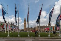 Flag poles around the park in front of the Big Ben