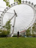 The London Eye, dan standing in front of it on a grassy knoll