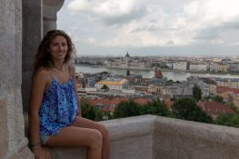 Tegan sitting on the ledge of a section of buda castle