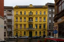 A bright yellow square building 4 stories high