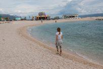 Tegan walking along the beach