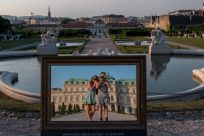 Standing in front of the mirror, reflecting the Belvedere Palace behind us