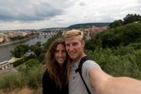 Couple shot from the top of a hill overlooking the Charles bridge