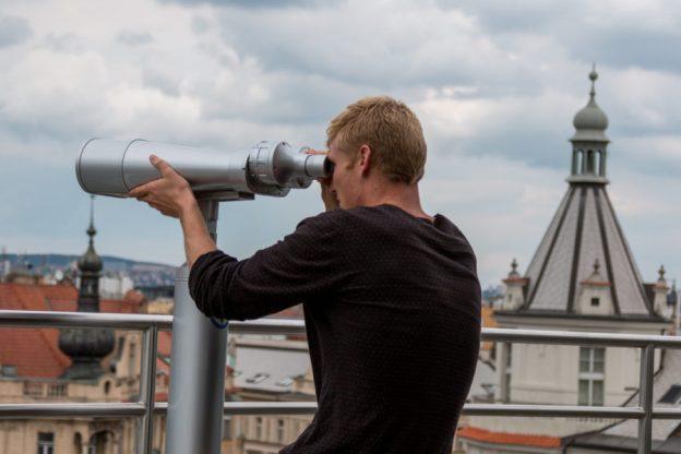 Daniel looking through giant binoculars