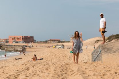 Tegan waving with Hossegor in the back ground