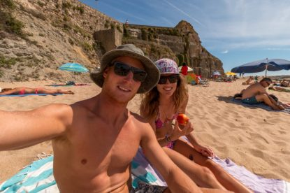 Us sitting on the beach, cliffs surrounding us