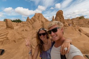 Us in front of the sand sculptures