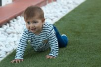 Baby Francisca crawling along the grass