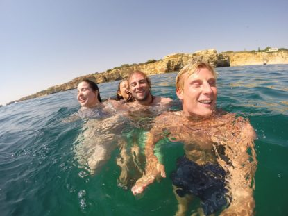 Us with our good friends Tony and Caitlin in the water all with our eyes shut