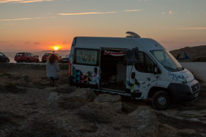 Sunset over the ocean behind our campervan