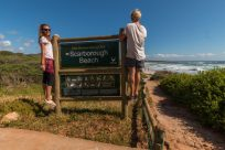Us standing on the sign with Scarborough beach