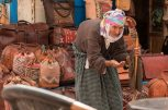 Old woman begging in the medina