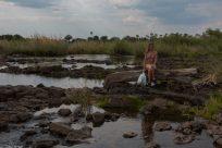 Tegs sitting on a log in the Zambezi River