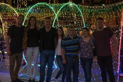 Manuelas family and us in front of the Christmas lights