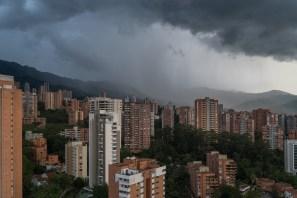 Dark stormy rain cloud looming over the city