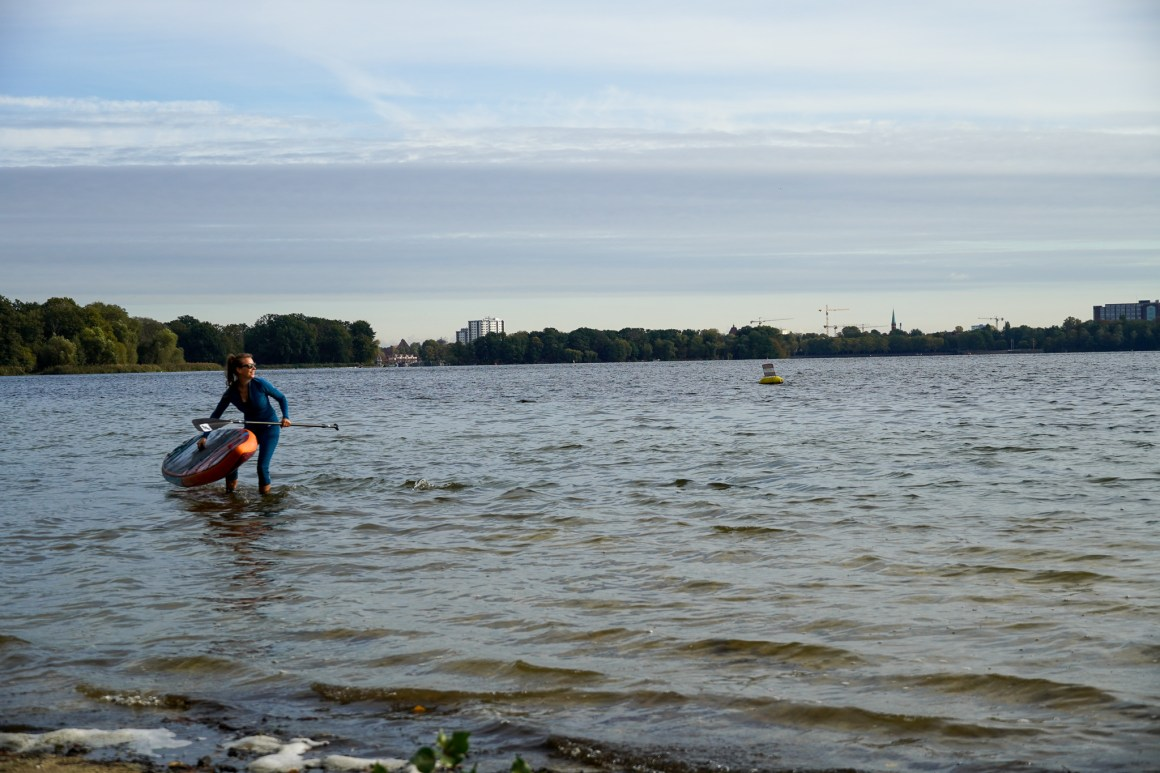 Stand up Paddler on her inflatable SUP at River Havel in Berlin