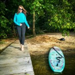 Stand up Paddler on her hardboard SUP at River Havel in Berlin