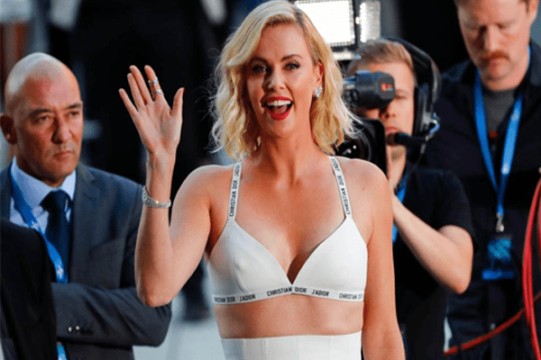 Charlize Theron rocks a white bra at the Atomic Blonde Berlin Premiere
