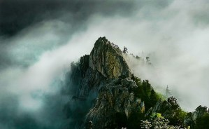 Mountain pick in clouds - about entrepreneurial overwhelm