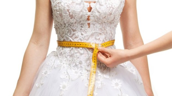Measuring woman's waist
