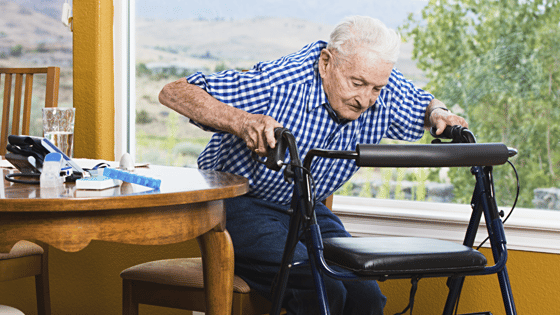 Elderly man using walker