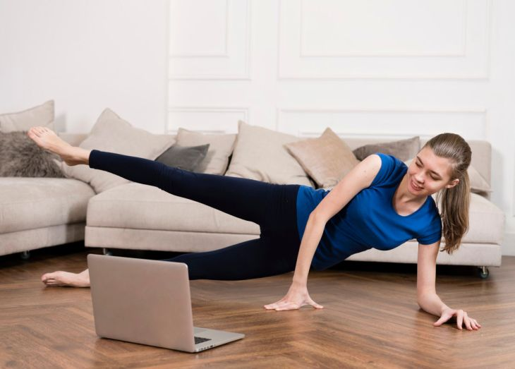 woman working out at home on her computer