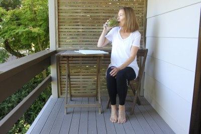 Donna Davidson drinking her daily Green Smoothie on the deck