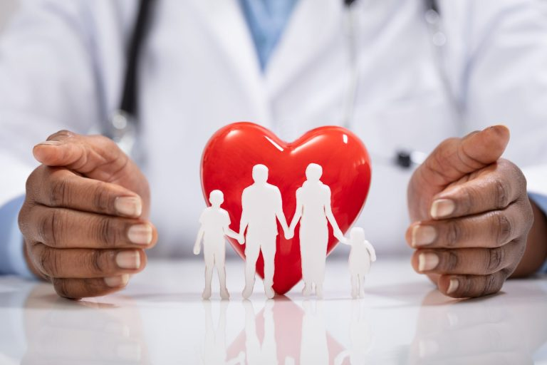 Doctor Protecting Family Cut Out And Heart Shape