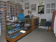 Molly manning the cash register in the visitor center