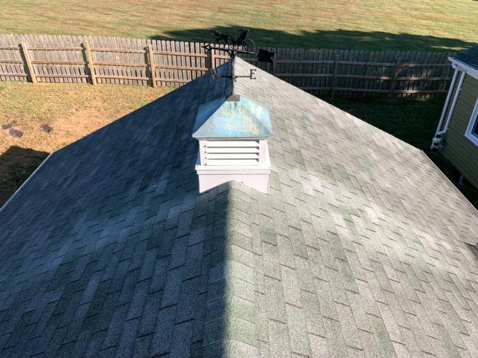 Old 3-tab roofing in Westminster MD, damaged by wind. We replaced this with a full architectural asphalt roofing system.
