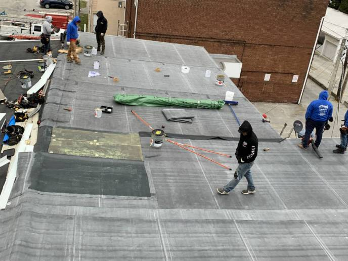 Installation of the rubber roofing system on York Street in Hanover PA