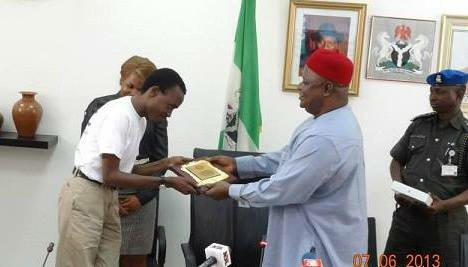 Opeyemi receives his plaque from the Secretary to the Government (SGF) of Nigeria