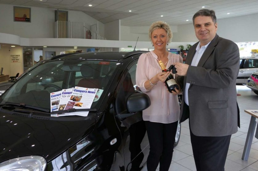 Steve presenting a prize car to Compers News reader Angie Reynolds