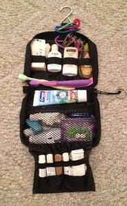 My kids' basic travel toiletry kit is a tiny hanging one from Samsonite.  Even though it's small, its various pockets and elastic straps hold tons of stuff, from their various shampoos and soaps to hair accessories, nail files and clippers, and a Neutrogena sunscreen stick.