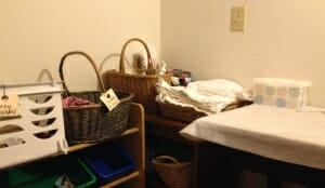 The baskets near my downstairs changing table include an easily-washable plastic one for dirty clothes.