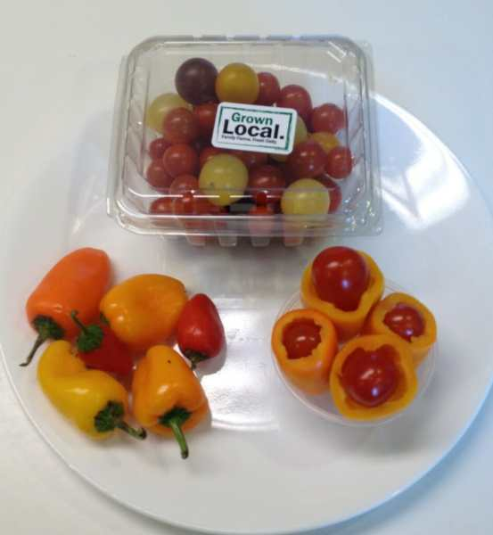 """Locally-grown cherry tomatoes plus locally-grown mini sweet peppers = a lunchbox fave my girls dubbed """"ice cream cones."""" Apparently, these two veggies are way more fun to eat when you stuff the tomato inside of the pepper, after you slice its end off and remove the seeds."""