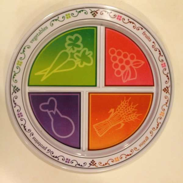 I found this divided MyPlate plate by Fresh Baby at a yard sale. It visually teaches your kids about a healthy diet, while cueing kiddos and grownups alike on portion control and balanced meals.