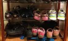 The bottom-most shelf on our just-inside-the-door shoe rack is where Essie's shoes go; the next shelf up is reserved for Kimmie's.